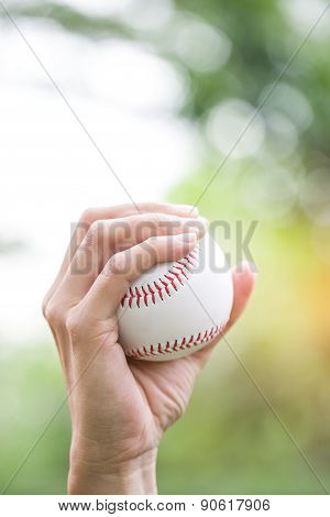 Close-up Of  Hand Holding Baseball