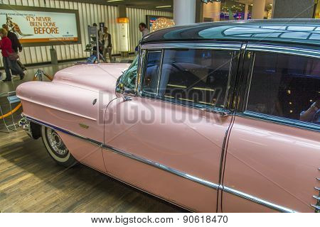 Pink 1956 Cadillac At The Airport