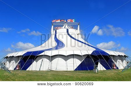 Circus tent in a field on a summer day.