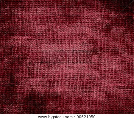 Grunge background of antique ruby burlap texture
