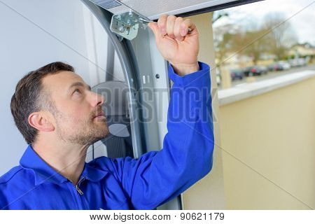 Man installing a garage door