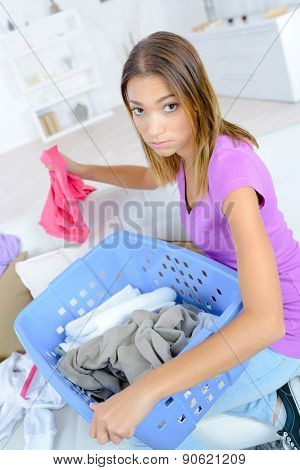 Woman sorting out the laundry