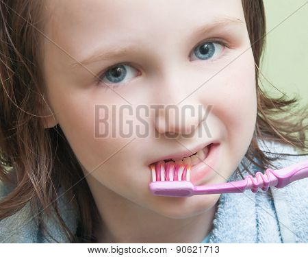 Girl Brushing Her Teeth