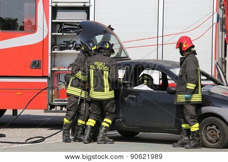 Firefighters And Relieve The Injured In Car