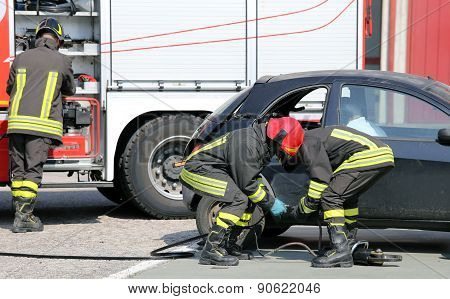 Practice Of Firefighters In The Firehouse With Simulation Of Road Accident