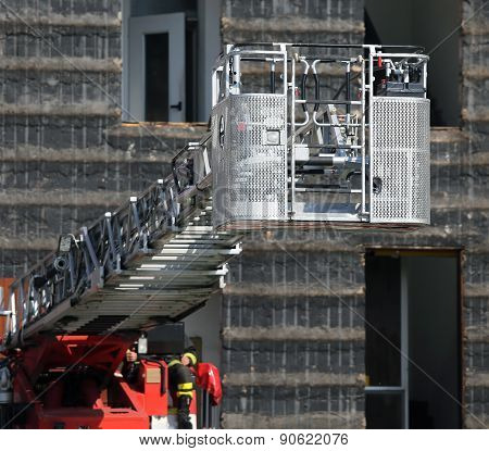 Big Ladder Rack Of Firefighters During Exercise In The Firehouse