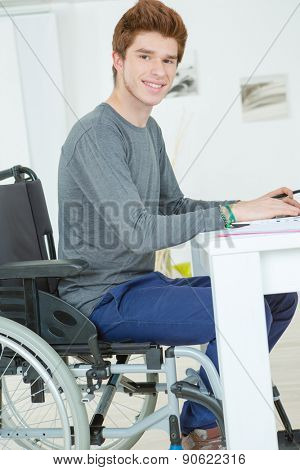 Handicapped teenager doing his homework