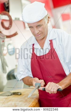 Butcher sharpening a knife