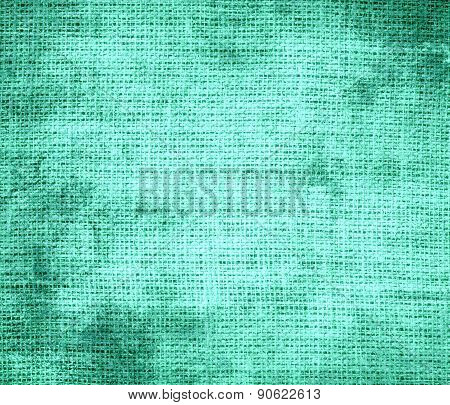 Grunge background of aquamarine burlap texture