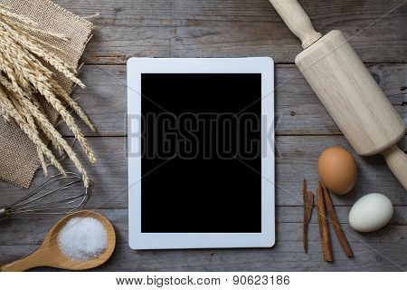 Food Ingredients , Kitchen Utensils And Tablet For Cooking On Wooden Background