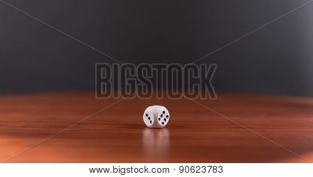 Single White Dice On Wood