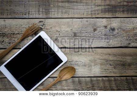 Tablet Served On Wood Plate. Concept