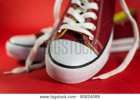 Closeup Of Red Canvas Trainers