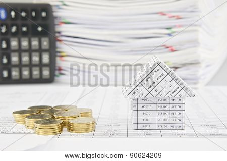 Pile Of Gold Coins And House On Finance Account