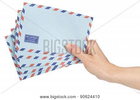 Female Hand Holding Air Mail Envelopes