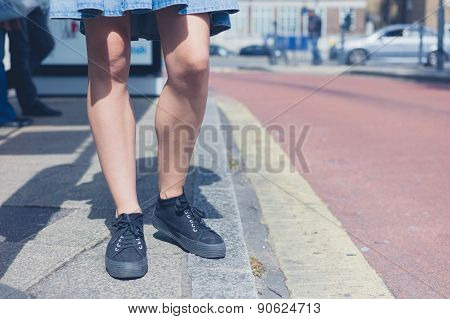 Legs Of Woman Waiting At Bus Stop
