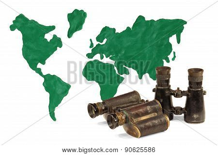 Two pair of binoculars and continents