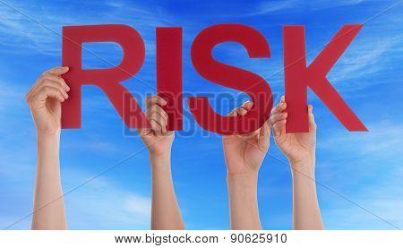 Hands Holding Red Straight Word Risk Blue Sky
