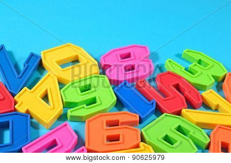 Plastic Colored Numbers On A Blue Background