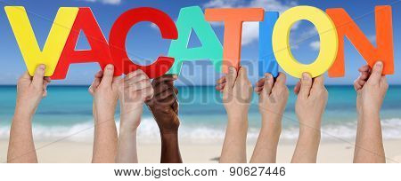 Hands Holding The Word Vacation On Beach And Sea
