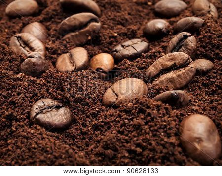 Coffee Beans And Ground Coffee Mixed