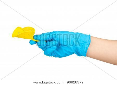 Gloved Hand Holding A Spoon For Dental Impression Isolated On White Background