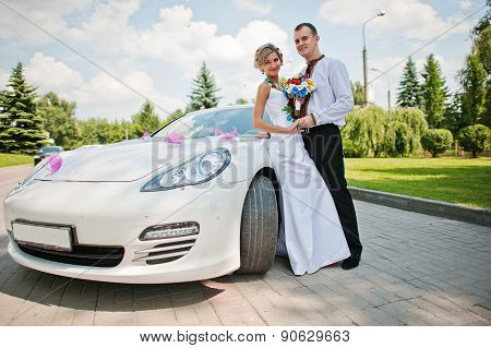 Wedding Beautiful Couple In Traditional Dress Near Exotic Supercar