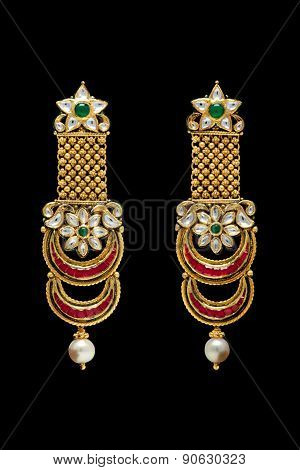Close up of golden earrings
