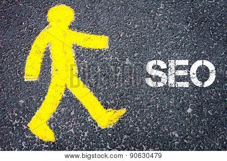 Yellow Pedestrian Figure Walking Towards Seo