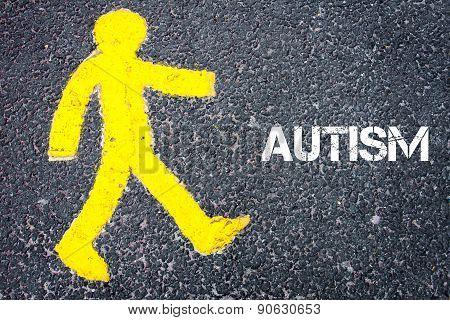 Yellow Pedestrian Figure Walking Towards Autism