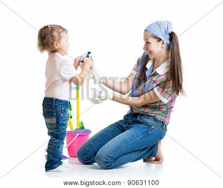mother with child cleaning room and having fun