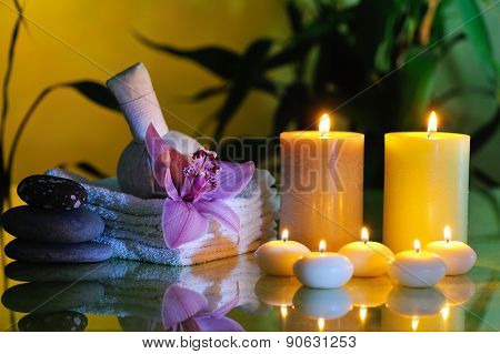 spa still life with lilac orchid on dark background