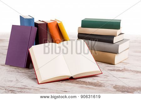 A Pile Of Different Book With An Open One