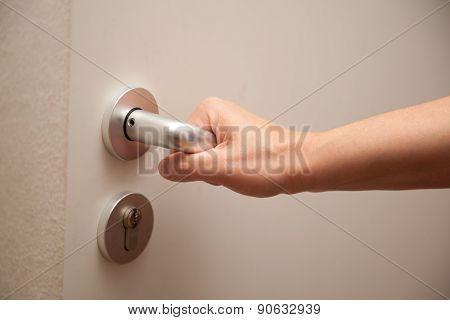 Woman Presses Door Handle