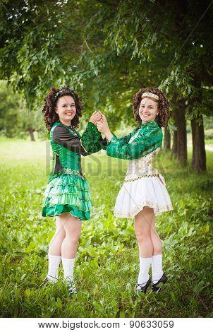 Two Young Beautiful Girl In Irish Dance Dress Posing Outdoor