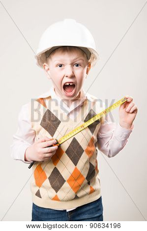 Boy In A Helmet With A Tape Measure And Emotionally Shouts