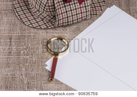 Paper Sheets And Magnifying Glass
