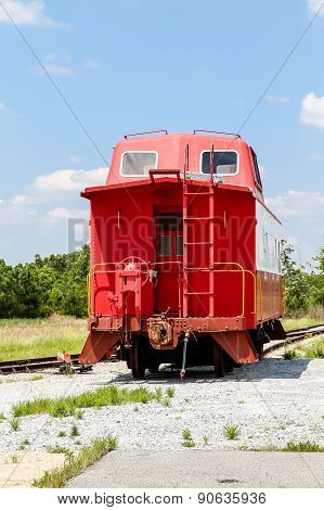 Red Caboose Under Blue Sky