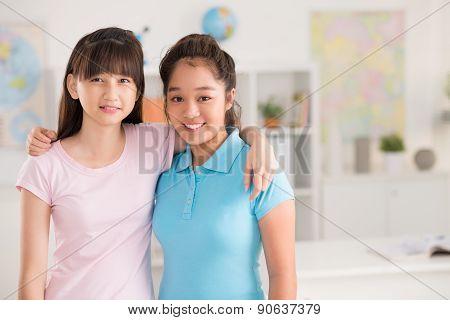 Hugging classmates