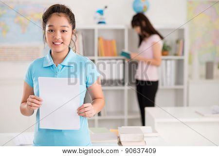 Schoolgirl with blank sheet of paper