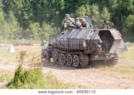 NELIDOVO, RUSSIA- JULY 12, 2014: Battlefield 2014: armored personnel carrier with Nazi soldiers