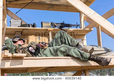 NELIDOVO, RUSSIA- JULY 12, 2014: Battlefield 2014: GI sleeps on the observation tower