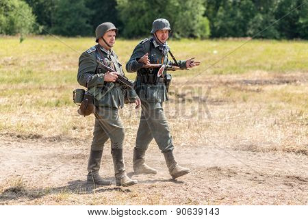 NELIDOVO, RUSSIA- JULY 12, 2014: Battlefield 2014: two Nazi soldiers go along the dusty road