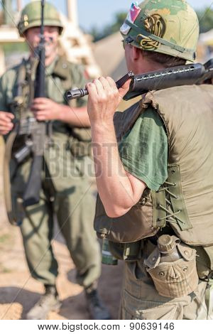 NELIDOVO, RUSSIA- JULY 12, 2014: Battlefield 2014: Two US soldiers with assault rifles