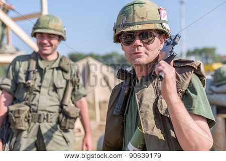 NELIDOVO, RUSSIA- JULY 12, 2014: Battlefield 2014: Two American soldiers in helmets with arms