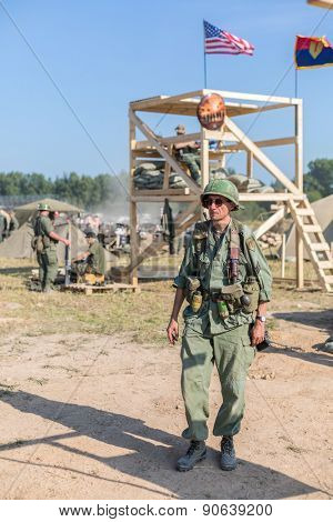 NELIDOVO, RUSSIA- JULY 12, 2014: Battlefield 2014: GI on a background of the observation tower with flags