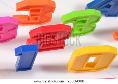 Colorful Plastic Numbers Close Up On A White
