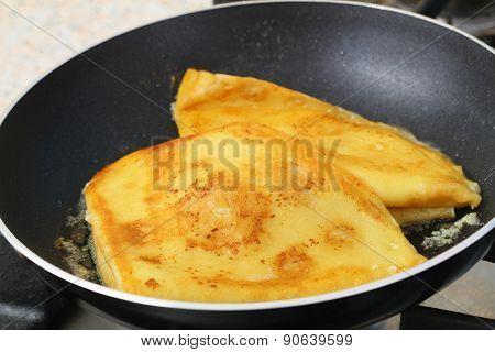 Pancakes fried in butter in frying pan