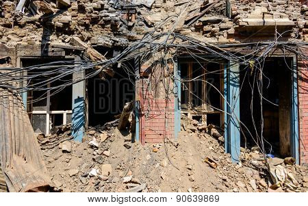 KATHMANDU, NEPAL - MAY 14, 2015: Damaged building and rubble after two major earthquakes that hit Nepal in the past weeks.