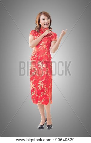 Chinese woman dress traditional cheongsam at New Year and introducing, full length portrait isolated.